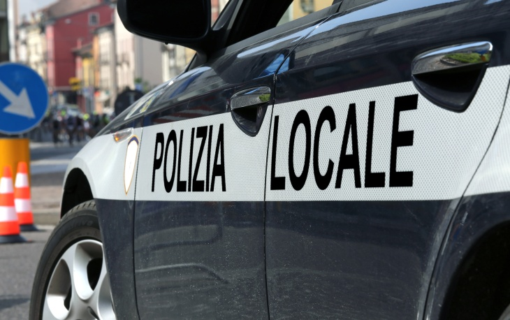 italian police car during the roadblock in the road